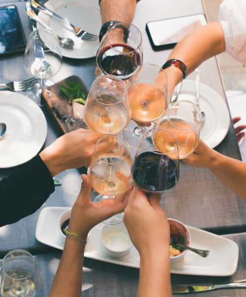 group-of-people-holding-wine-glasses-1097425